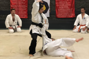 Sempai demonstrating Judo Throw