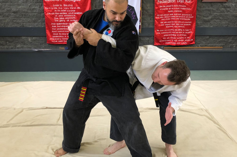 Shihan demonstrating a Reserse Armbar